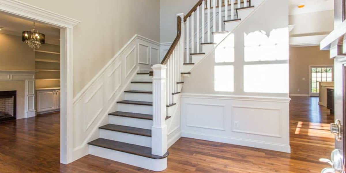 Oak Tread Stairs with Raised Panel Wainscoting